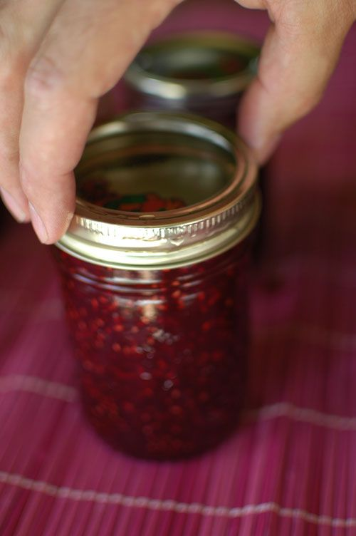 Canning raspberry jam - easy to make and the licked off the spoon while making it bits were good. Now I can't wait to use up the store bought stuff in the fridge so we can try this for real!