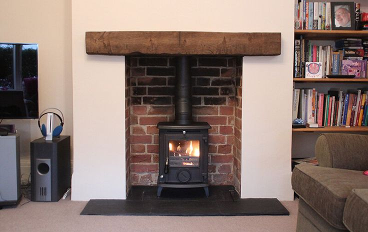 Bricks inside fireplace, wood, black hearth