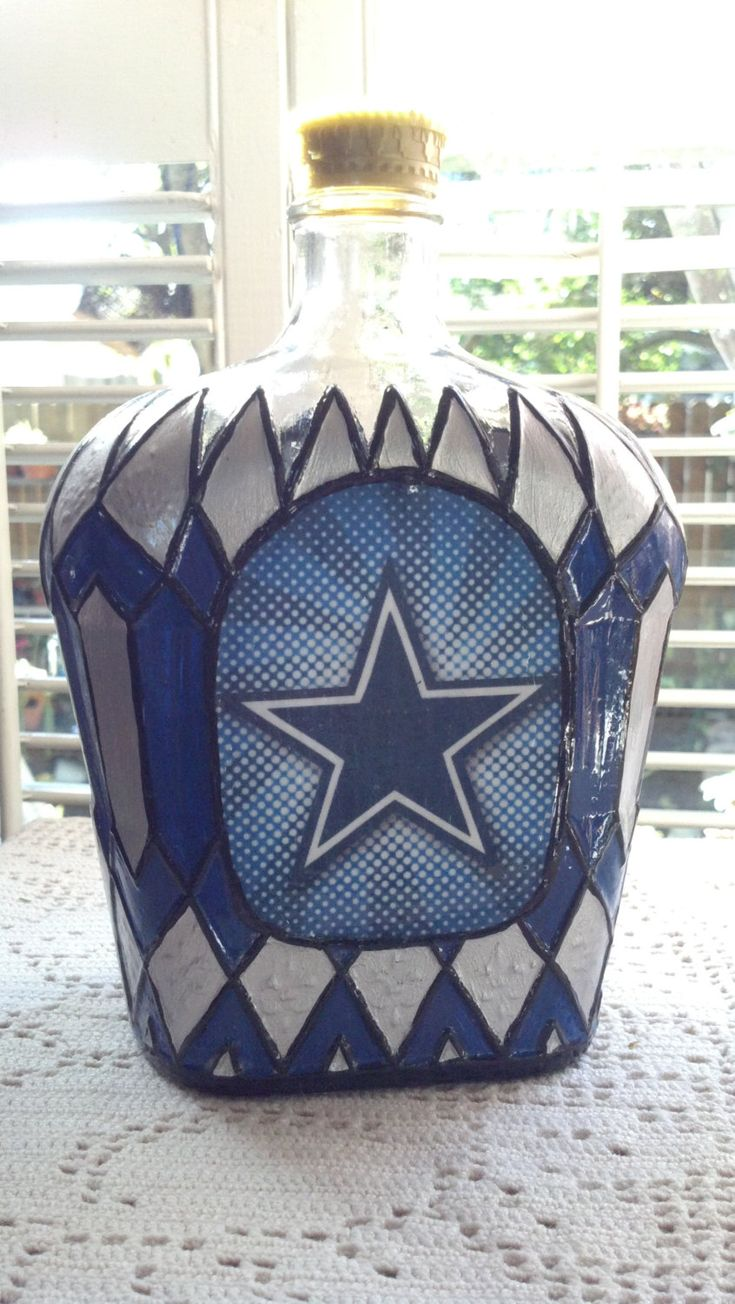 Hand Painted Dallas Cowboys Crown Royal Glass 1Liter Bottle Decanter Made from a recycled empty Crown Royal Glass 1Liter Bottle... Each bottles is ONE OF A KIND. GREAT CONVERSATION PIECE. great gift for the Cowboys Fan. 9 tall MAN CAVE, BAR DECOR, LIQUOR DECANTER