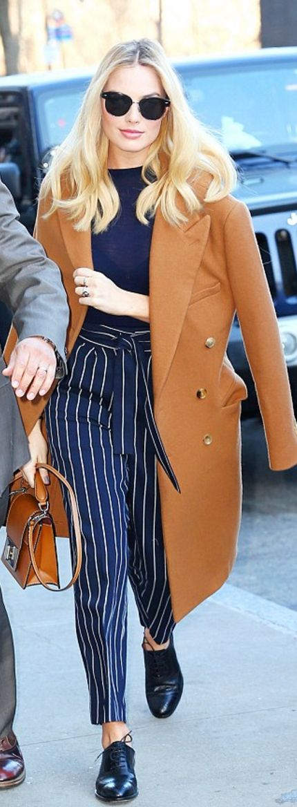 Margot Robbie's tan coat > Calvin Klein and brown handbag> Marc Jacobs