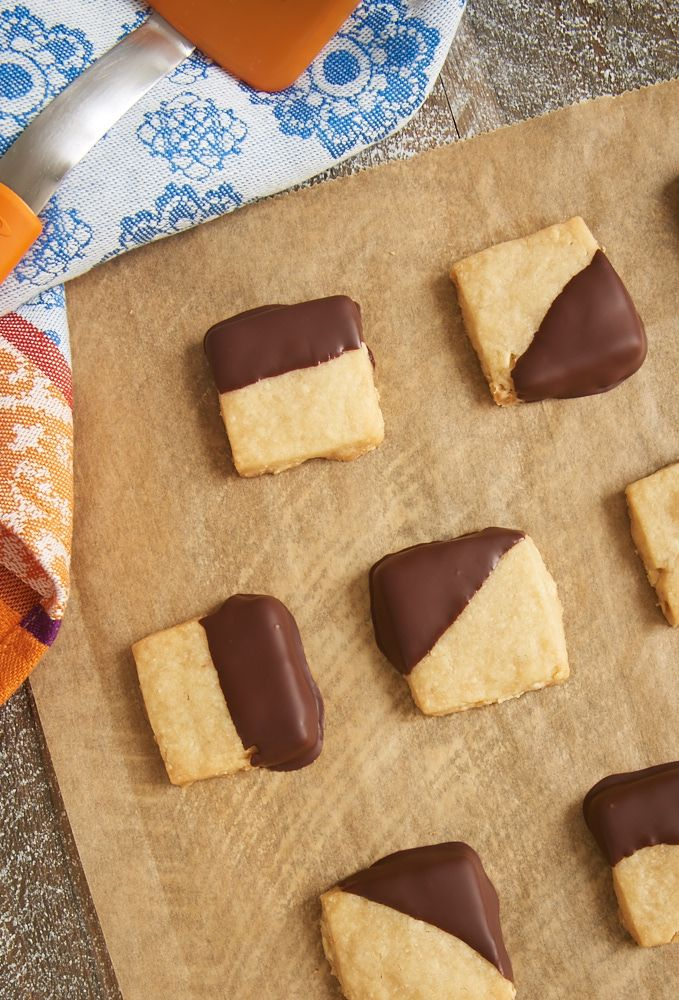These quick and easy Chocolate-Dipped Hazelnut Shortbread are so addicting! The nutty, delicate shortbread combine perfectly with a bit of dark chocolate. ~ http://www.bakeorbreak.com