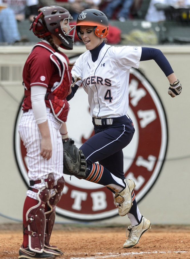 I love Baylees face as she scores during the  SEC softball game with Auburn, Saturday. Auburn scored a 7-4 upset of the #4-ranked Tide. What a great day to be an Auburn tiger.