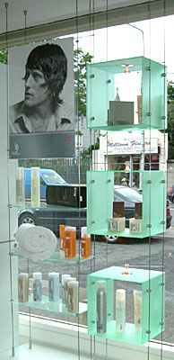 Suspended acrylic cubes are a fabulous way to showcase products in your window!