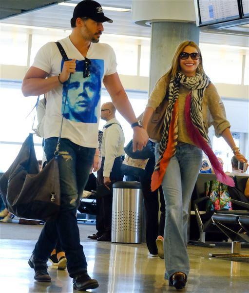 Joe Manganiello and Sofia Vergara arrive on a flight in Miami on July 24, 2014.