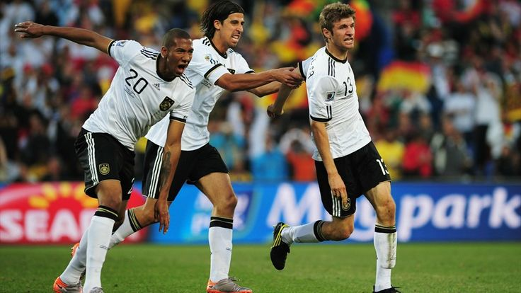 BLOEMFONTEIN, SOUTH AFRICA - JUNE 27: Thomas Mueller of Germany (R) celebrates scoring with teammates Jerome Boateng (L) and Sami Khedira (C) during the 2010 FIFA World Cup South Africa Round of Sixteen match between Germany and England at Free State Stadium on June 27, 2010 in Bloemfontein, South Africa. (Photo by Shaun Botterill - FIFA/FIFA via Getty Images)