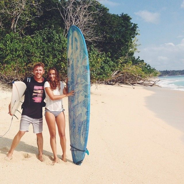 Surfer girl with her BF at G-Land Surf Spot, East Java, Indonesia