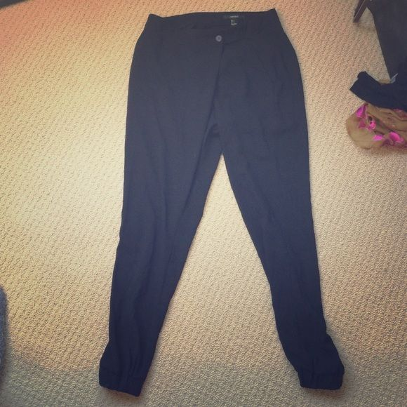 Black sophisticated jogger  slacks pants These are jogger pants with lower crotch but with a cleaner look and lines. Has buttons to close and material is not cheap but look more like slacks Forever 21 Pants