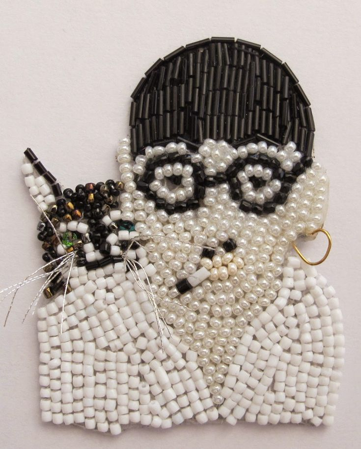 Beaded person with cat and glasses broach by marianne batlle