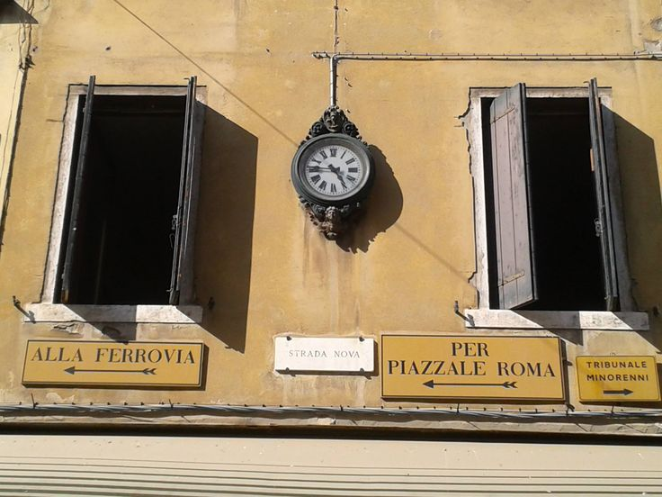 Venice - street details. Love these old clocks