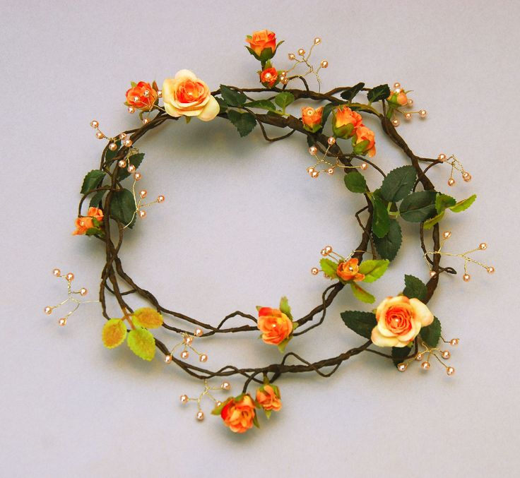 Peach pink rose circlet with pale pearls strung on a golden wire. On Yew Tree Workshop