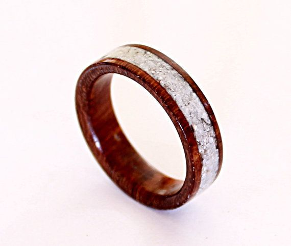 Womens wood ring with crushed shell inlay    A beautiful ring for women made of mahogany wood and inlaid with hand crushed shell pieces.    These