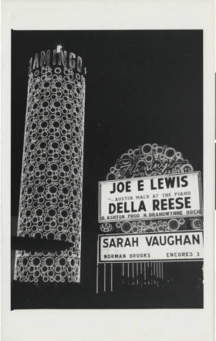 "The Champagne Tower at the Flamingo Hotel with neon bubbles that floated to the top. From UNLV Libraries ""Dreaming the Skyline: Resort Architecture and the New Urban Landscape"" digital collection."
