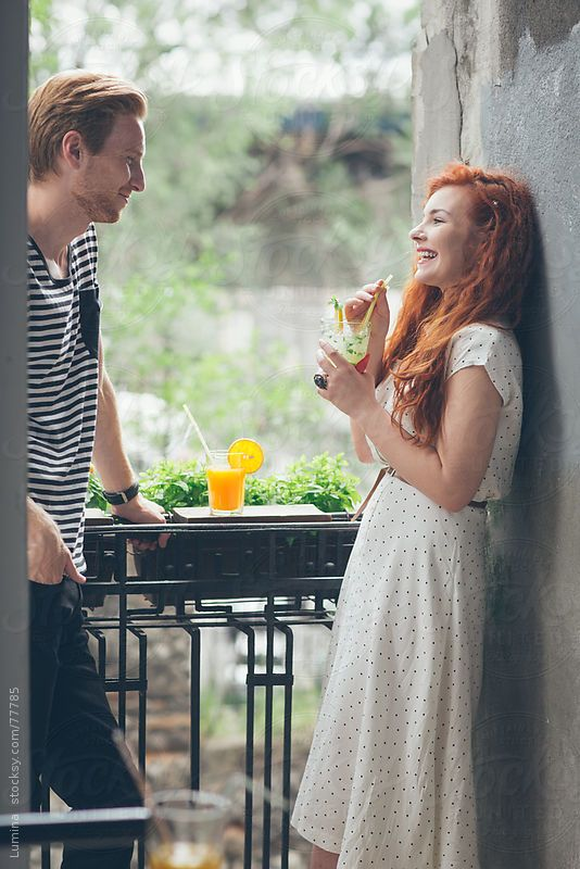 Ginger Couple Having a Drink on a Balcony by Lumina