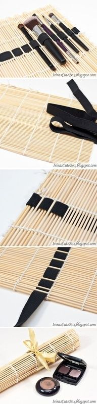 bamboo placemat or sushi roller repurposed to hold makeup brushes - only need a ribbon. I would use it for art tools tho...
