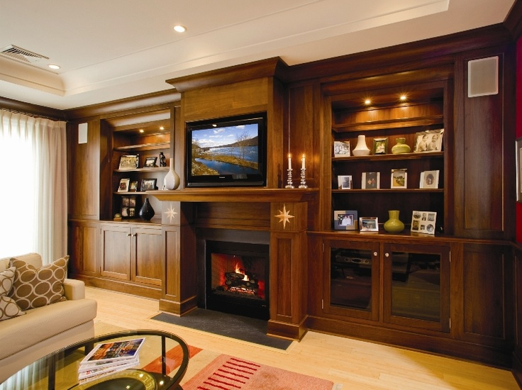 built in book shelves and entertainment center with fireplace surround