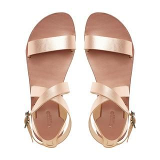 This minimalist leather sandal is your perfect go-to summer style. Cut high on the ankle with buckle, open back and crossover slotted straps. Its sleek styling looks great with casual looks.