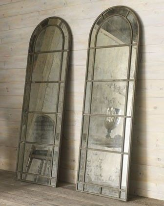 Arched mirrors that tell a story about themselves as well as about you.