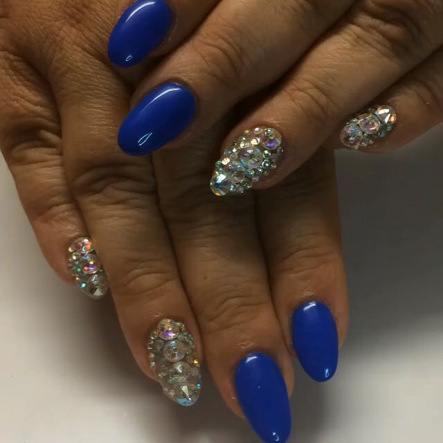 Almond shape gel nails , blue with Swarovski diamonds