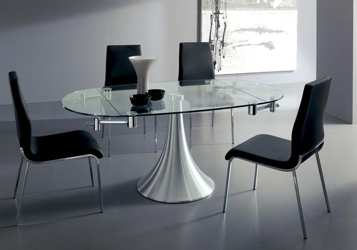 FLUTE. Contemporary materials such as aluminum and glass are smartly used a pure form. Extending dining table with aluminium column, glass top and visible extensions under the top. http://www.easy-line.it