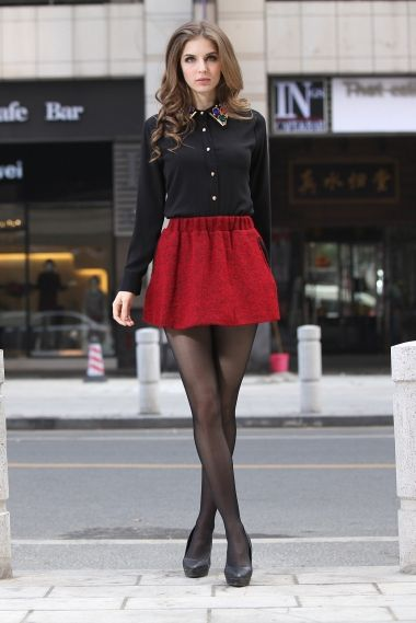 Perfect holiday outfit. Black chiffon collared shirt, red skater skirt, tights and heels. It'd be cute with a subtle pattern on the tights, too. Boots would be cute, too.