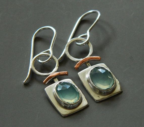 Caribbean Blue Chalcedony is a highlight of these mixed metal earrings. Mostly sterling silver, with copper accents, theyll match plenty of