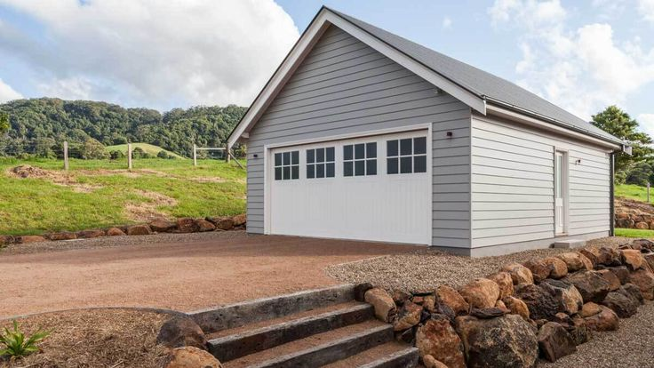 Garages and Carports - Strongbuild. One of my favourites - simple and will go well with the house.