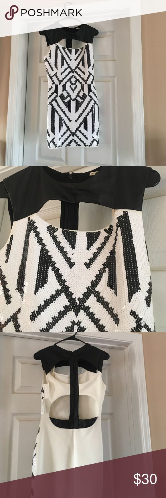 Black and white sequin dress Never worn black and white sequins dress with cut outs in the back. Necessary Clothing Dresses Midi