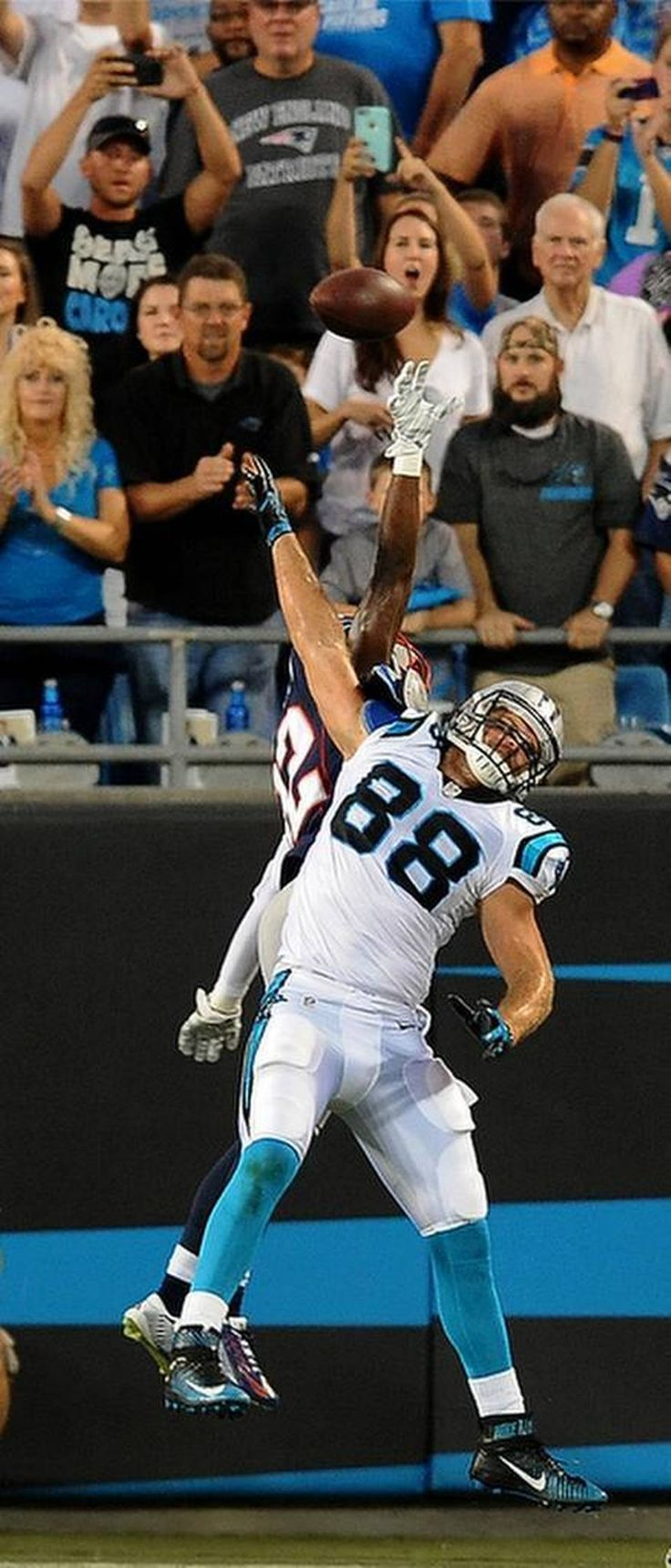 Carolina Panthers tight end Greg Olsen is unable to make a reception of a pass from quarterback Cam Newton in the red zone as New England Patriots defensive back Devin McCourty applies defensive pressure during first quarter action at Bank of America Stadium in Charlotte, NC on Friday, August 28, 2015.