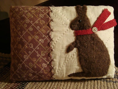 primitive rabbit on quilt pillow