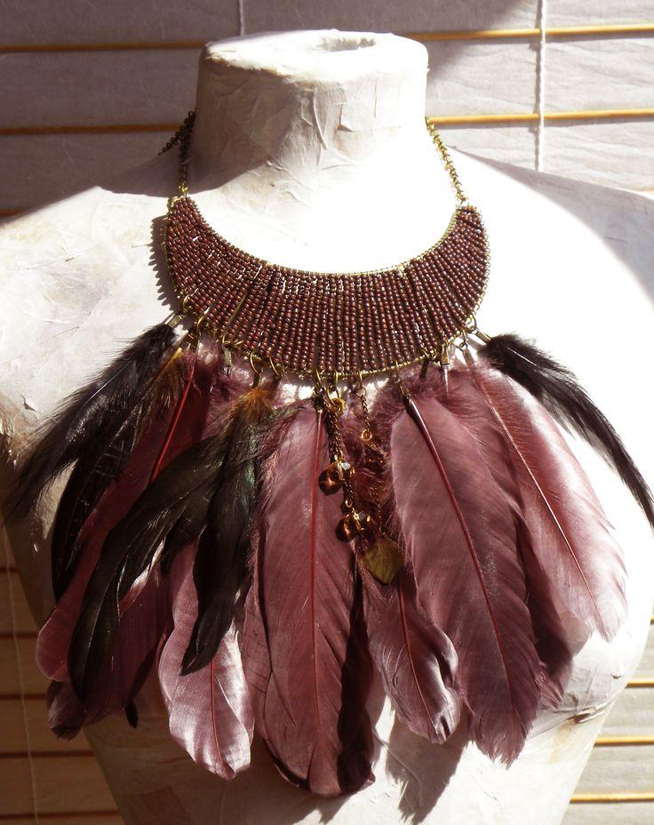 Feather necklace, from moon shape, by Elena Gutierrez Giulianotti.