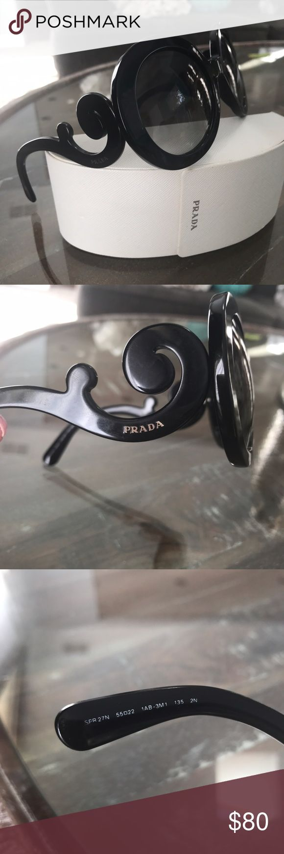 Prada baroque sunglasses Gently used Prada baroque sunglasses in black...some very minor scratches only noticeable when looking at very close..in great condition! Comes with Prada sunglasses case Prada Accessories Sunglasses