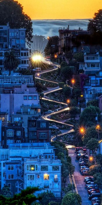 Lombard Street, San Francisco, California. A street famous for a steep, one-block section with eight hairpin turns. This and many other great places to visit in San Francisco can be found on theculturetrip.com