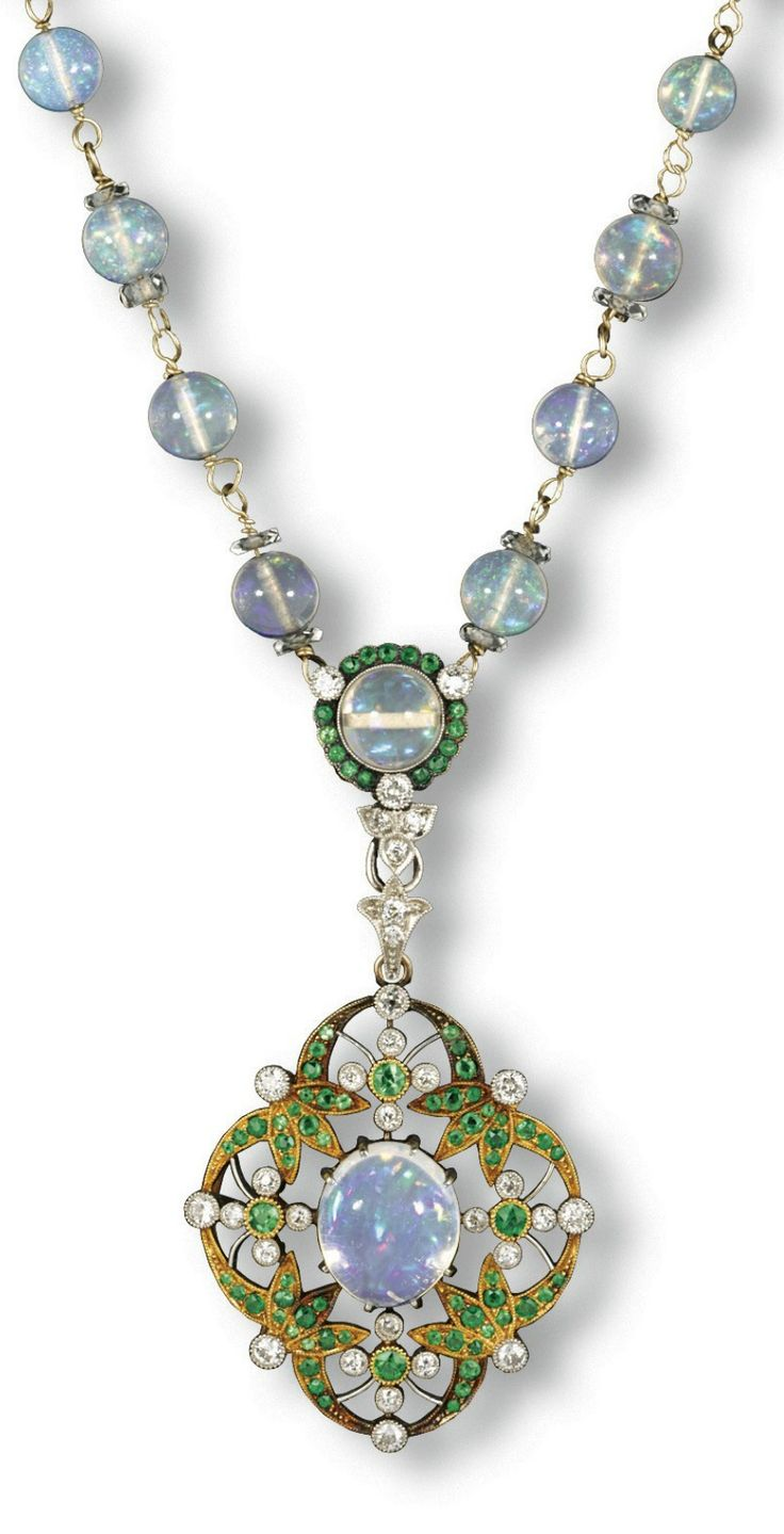 A BELLE EPOQUE JELLY OPAL, DIAMOND AND DEMANTOID GARNET PENDENT NECKLACE, 1895-1910. The detachable mille-grain pendant centring upon a jelly opal, within a foliate quatrefoil surround set with diamonds and demantoid garnets, suspended by an opal encircled by demantoid garnets to the diamond trefoil motif, with a neckchain composing of further round opals, each alternating opal flanked by diamond rondelles, mounted in white and yellow gold.