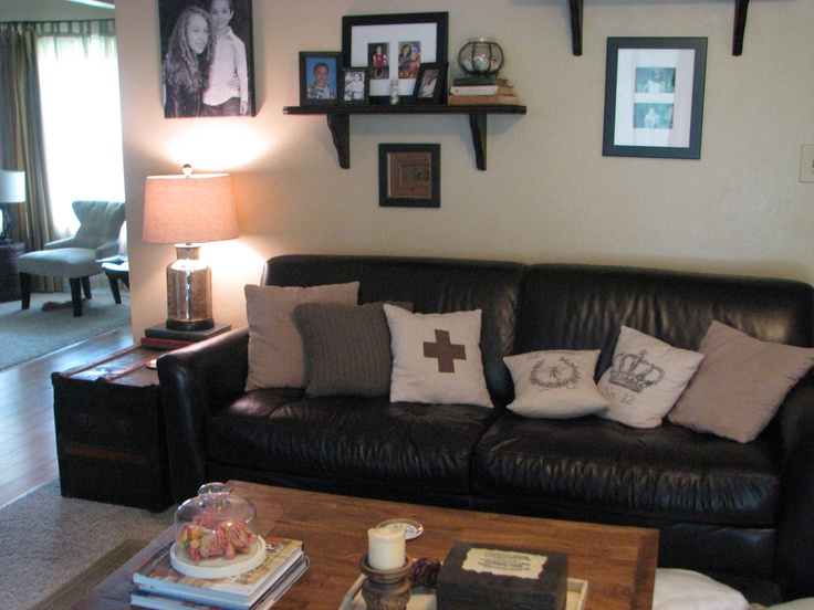 lots of neutral pillows on my own brown leather couch