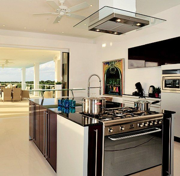 The kitchen of Grand Bleu (Terres Basses, St. Martin) has Smeg appliances and a retractable wall that opens to an alfresco dining terrace with sea views. Contact Tim Roney, LaCURE Villas.