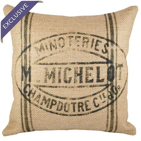 Handmade from burlap and showcasing a weathered typographic motif, this eye-catching pillow lends factory-chic appeal to your living room or master suite.
