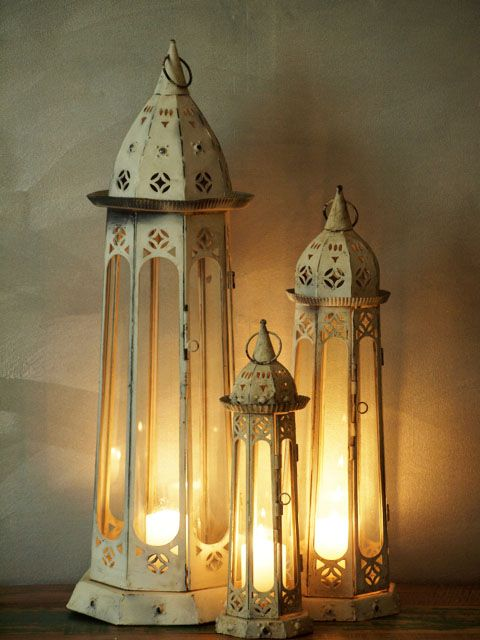 66cm high x 22cm wide. These rustic whitewashed Indian lanterns will add some charm to your room. Will look great outside on those BBQ evenings.www.exoticimports.co.nz