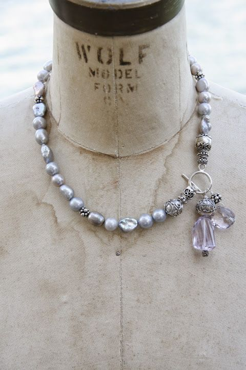 Grey baroque pearls with lilac amethysts and sterling silver accents.