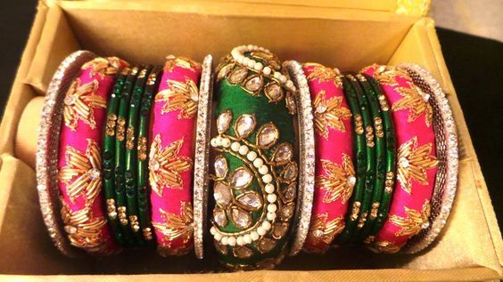 A South Indian bride's pride is her gorgeous Kanchipuram sarees which are further complimented by the colourful, matching bangles. The traditional sarees and bangles combo enhance and accentuate he...