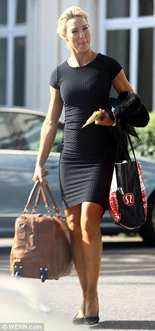 Necessities: Natalie Lowe came equipped to the rehearsal with a tan bag one hand and a ban...