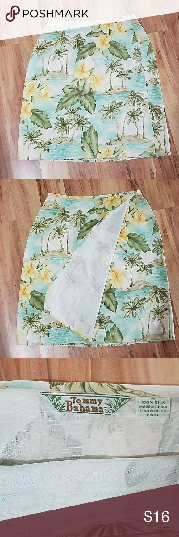 Tommy Bahama Hawaiin print skirt size 4 EUC Tommy Bahama beautiful Hawaiin skirt aqua and yellow and green colors. Wrat around skirt with small buttons to fasten. Falls above knee Tommy Bahama Skirts Midi
