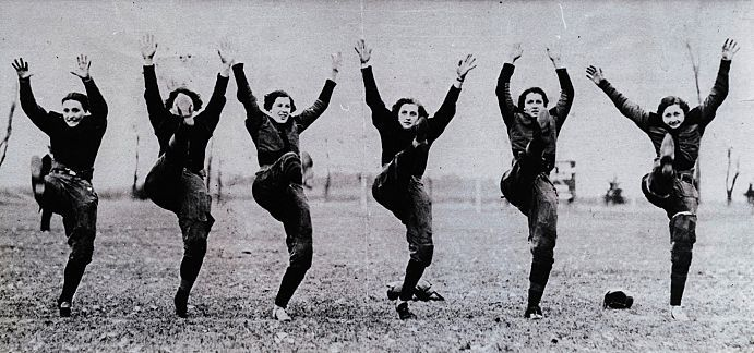 During the early 1920s, Gustavus Adolphus College had a Women's Football team. Pictured is a photo of some of the women on the team. The photo accompanied an article in a Novemer 1924 edition of the Saint Paul Pioneer Press about the team's season. Courtesy of the Gustavus Adolphus College Archives, GACA 162, P-01834.