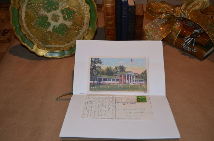 """Handcrafted """"Haunted Asylums"""" journal with a reproduction of a vintage asylum postcard from the author's personal collection."""
