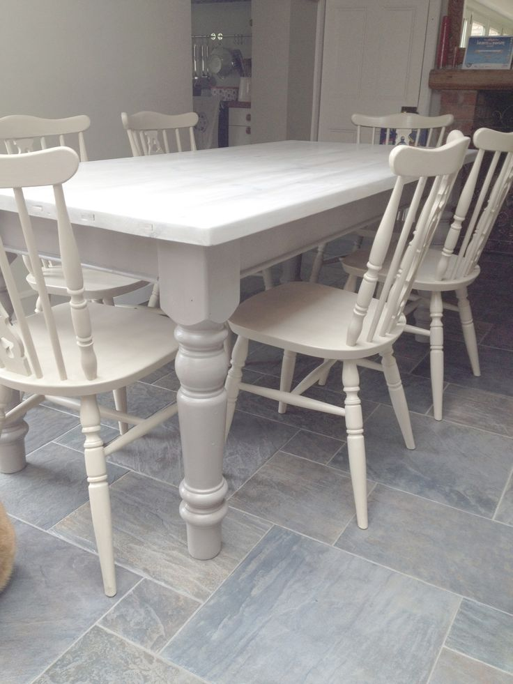 Dining chairs given a 2 colour distress using Annie Sloan Cream over Country Grey. Dining table legs painted French Linen and top white washed using Old White.