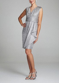 Wow in this fabulous cap sleeve shimmer dress! Cap sleeve bodice features empire ruched waist that creates a slimming silhouette. Stretch shimmer fabric is stunning and comfortable. Cascading side ruffle adds dimension to this already beautiful ensemble. Fully lined. Back zip. Imported poly/rayon/nylon blend. Dry clean.A very short, often rounded sleeve that barely covers the top of the shoulder.A very short, often rounded sleeve that barely covers the top of the shoulder.A bodice with a…
