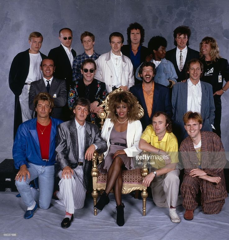 Internationally famous musicians gather for the Prince's Trust 10th Anniversary Rock Gala at Wembley, 23rd June 1986. From left to right (top row) Mark King of Level 42, Ray Cooper, Bryan Adams, Midge Ure, John Illsley, Joan Armatrading, Paul Young, Rick Parfitt; (middle row) Francis Rossi, Elton John, Eric Clapton, Mark Knopfler; (front row) Rod Stewart, Paul McCartney, Tina Turner, Phil Collins, Howard Jones.