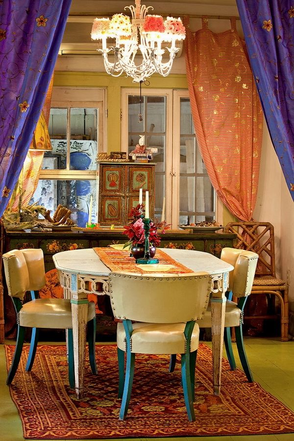 Vibrant colors and curtains that define this space make for Dining room definition
