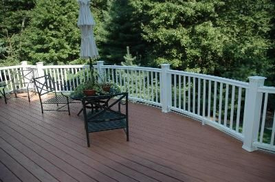 Redwood composite deck with white railings fun in the for White composite decking