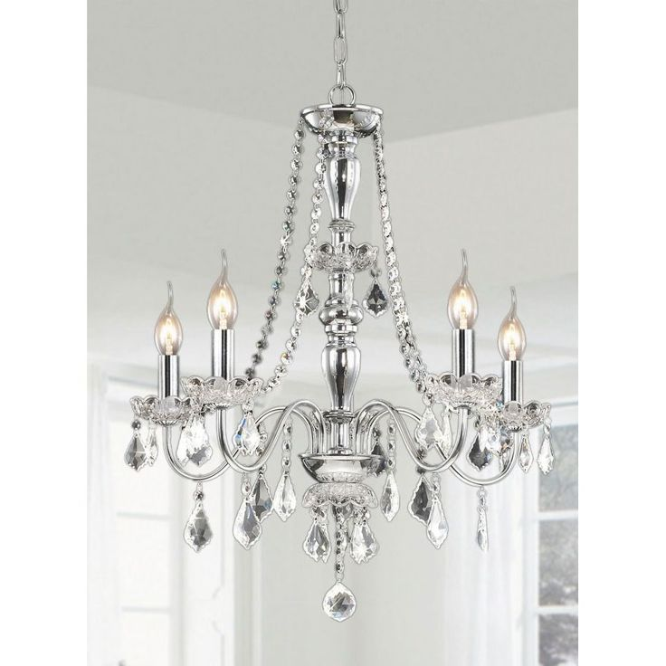 This traditional five-light chrome crystal chandelier elevates the decor of your home. The lights feature clear crystal shades to accent the chrome finish of the chain. This hanging lamp offers 40 inches of chain, for a variety of ceiling heights.