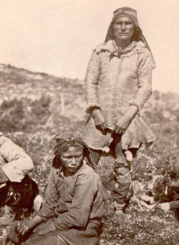 Innu hunter from northern Labrador wearing a caribou-skin coat, ca. 1910